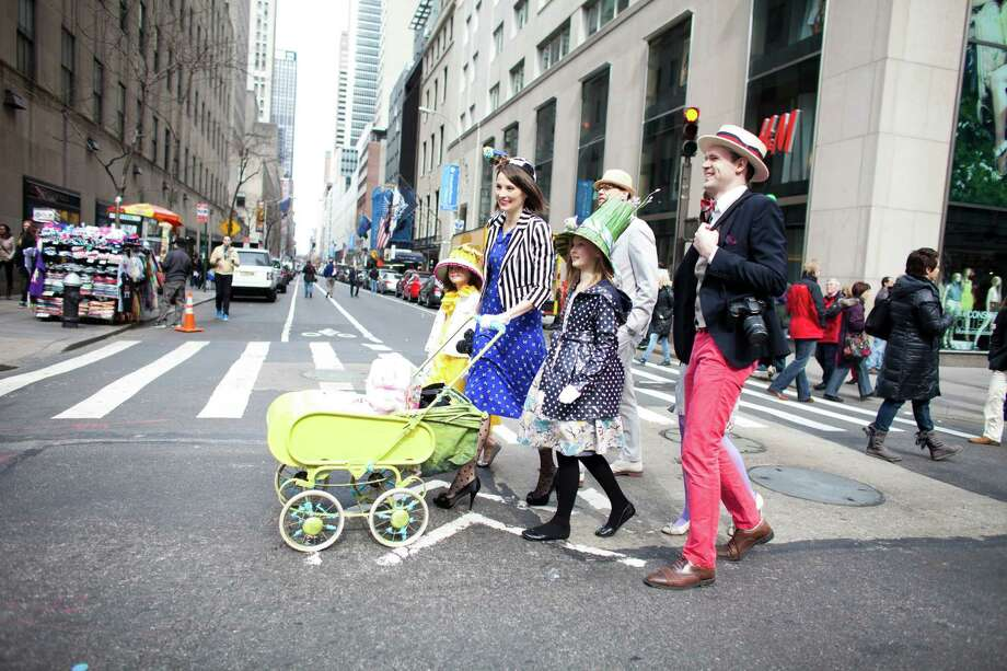 NEW YORK, NY - MARCH 31: A family arrives for the annual Easter Day procession on 5th Avenue March 31, 2013 in New York City. The annual festivities attracts hundreds of New Yorkers gathering in front of St. Patrick's Cathedral wearing colorful hats and costumes celebrating one of the holiest days in the Christian calendar. Photo: Ramin Talaie, Getty Images / 2013 Getty Images