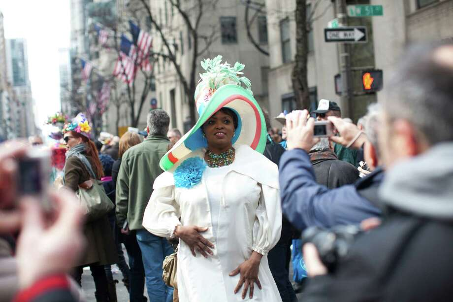 NEW YORK, NY - MARCH 31: Revelers participate in the annual Easter Day procession on 5th Avenue March 31, 2013 in New York City. The annual festivities attracts hundreds of New Yorkers gathering in front of St. Patrick's Cathedral wearing colorful hats and costumes celebrating one of the holiest days in the Christian calendar. Photo: Ramin Talaie, Getty Images / 2013 Getty Images