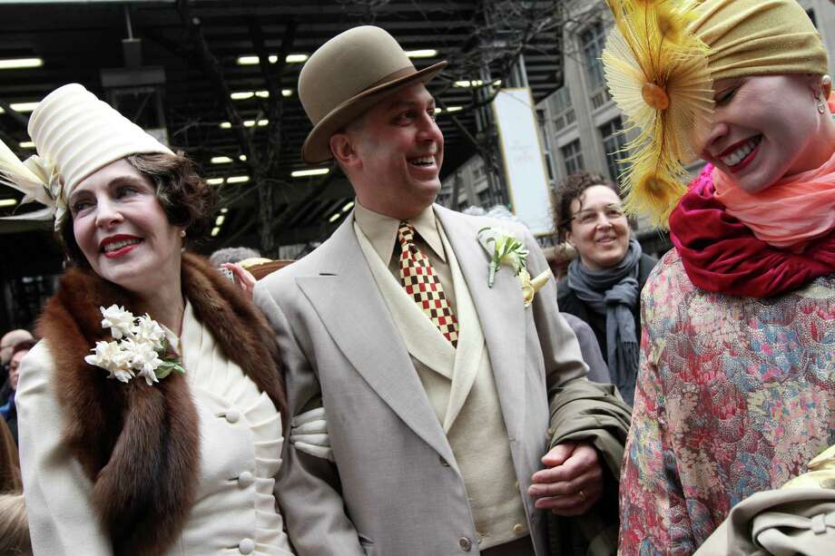 Dressed for the occasion, Gretchen Fenston, left, Roddy Caravella, second from left, and Kathleen McGowan, right, all from the Brooklyn borough of New York, pose for photographs on New York's Fifth Avenue as they take part in the Easter Parade Sunday March 31, 2013. Photo: Tina Fineberg, AP / FR73987 AP