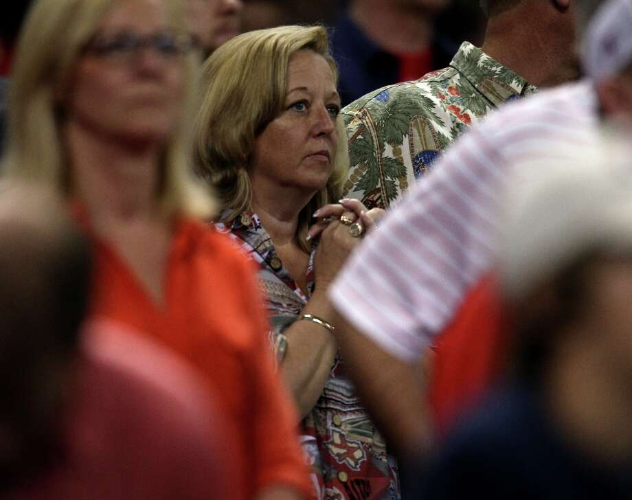 Astros fans stand for the final out during the ninth inning. Photo: Karen Warren / © 2013 Houston Chronicle