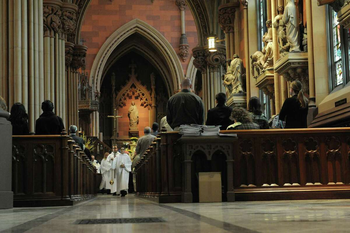 Incense is used as the procession winds its way through the aisles of the Cathedral of the Immaculate Conception during the Easter Sunday service on Sunday, March 31, 2013 in Albany, NY. (Paul Buckowski / Times Union)