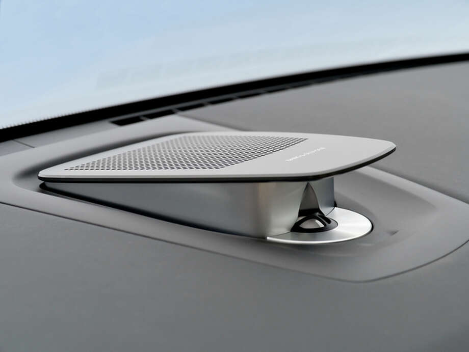 This dash-mounted speaker is part of the Bang & Olufsen sound system. It opens and closes much like a clam.