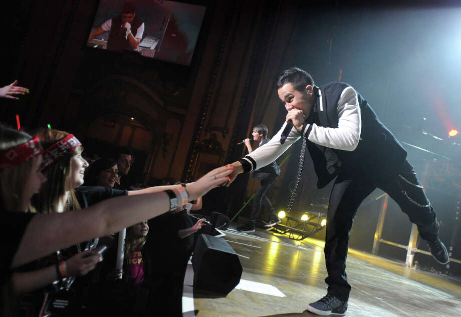 Carlos Pena, Jr. of Big Time Rush touches the hand of a fan during a performance at the Palace Theatre Tuesday, Feb. 28, 2012 in Albany, N.Y.  (Lori Van Buren / Times Union) Photo: Lori Van Buren, Albany Times Union / 00016551A