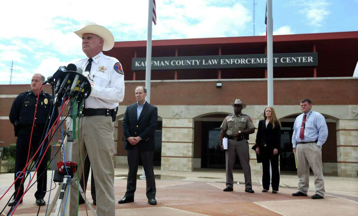 Kaufman County Sheriff David Byrnes, center, speaks at a news conference, Sunday, March 31, 2013, in Kaufman, Texas. On Saturday, Kaufman County District Attorney Mike McLelland and his wife, Cynthia, were murdered in their home. (AP Photo/Mike Fuentes)