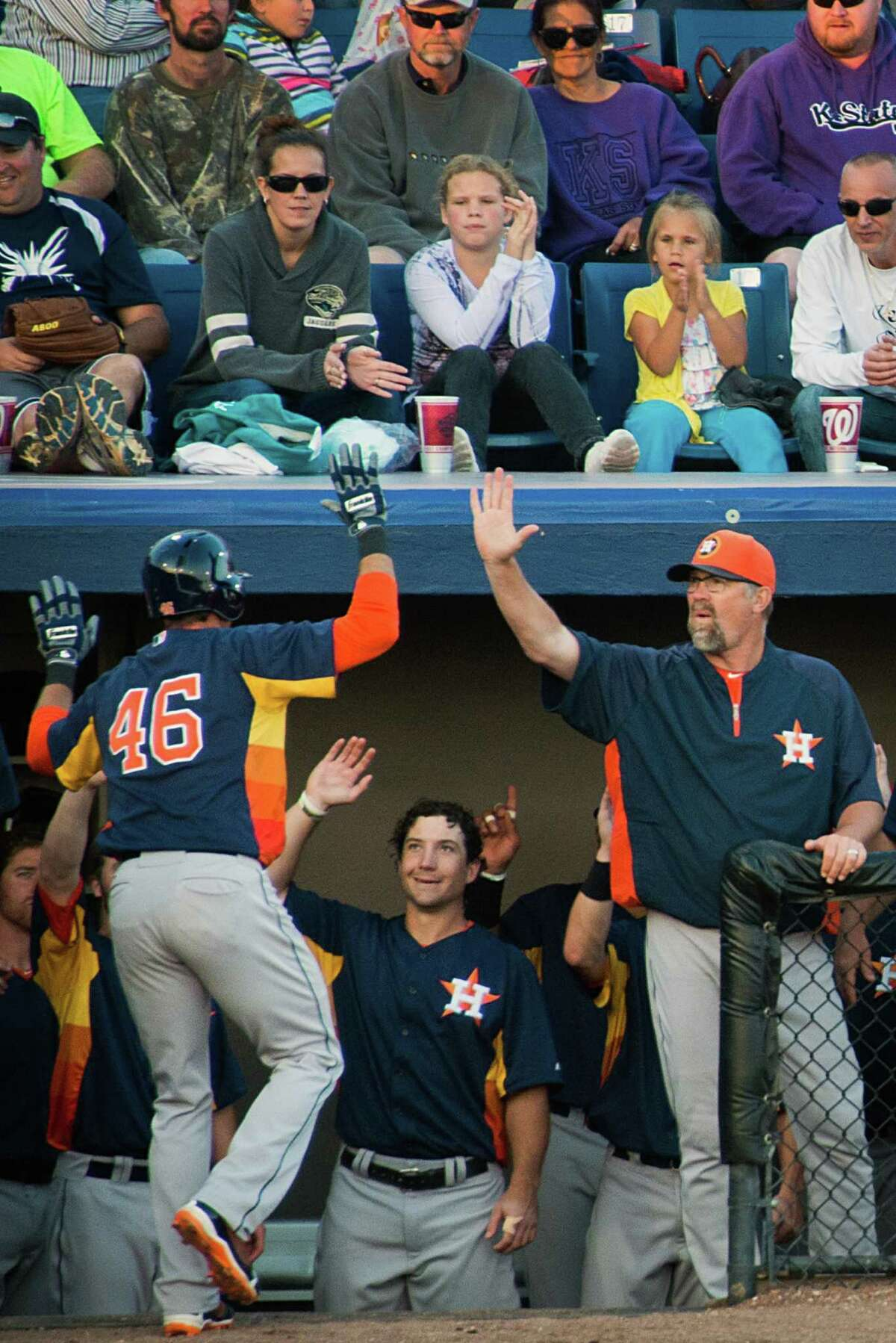 Houston Astros outfielder Rick Ankiel gets a high-five from pitching coach Doug Brocail after hitting a home run during the fourth inning of the Astros 4-2 victory over the Washington Nationals in a spring training exhibition game on Saturday, March 16, 2013, in Viera, Fla. ( Smiley N. Pool / Houston Chronicle )