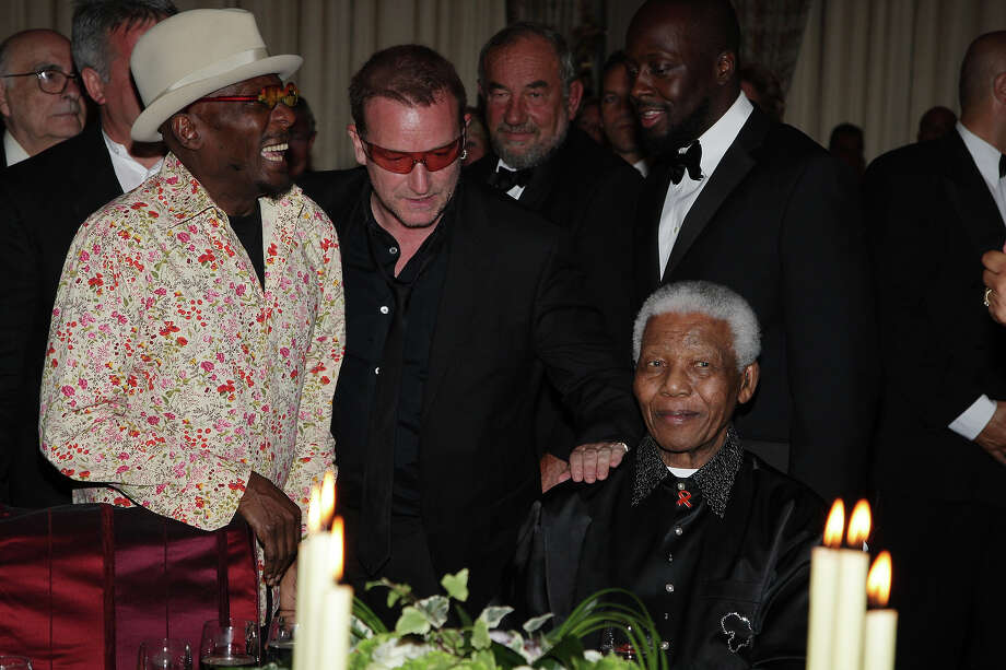 Jimmy Cliff, Bono, Wycleff Jean and Nelson Mandela attend the 'Unite For A Better World Gala Dinner' on September 2, 2007 at the Hotel de Paris in Monte Carlo, Monaco. Photo: Pascal Le Segretain, Getty Images / 2007 Getty Images