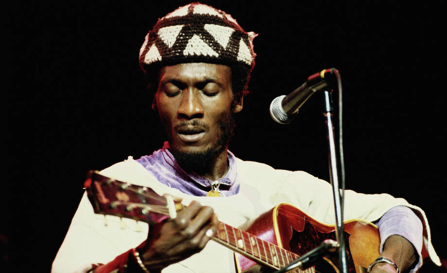 Jamaican reggae singer Jimmy Cliff performs on stage at the Hammersmith Odeon, London in 1978. Photo: David Redfern, Redferns / 1978 David Redfern