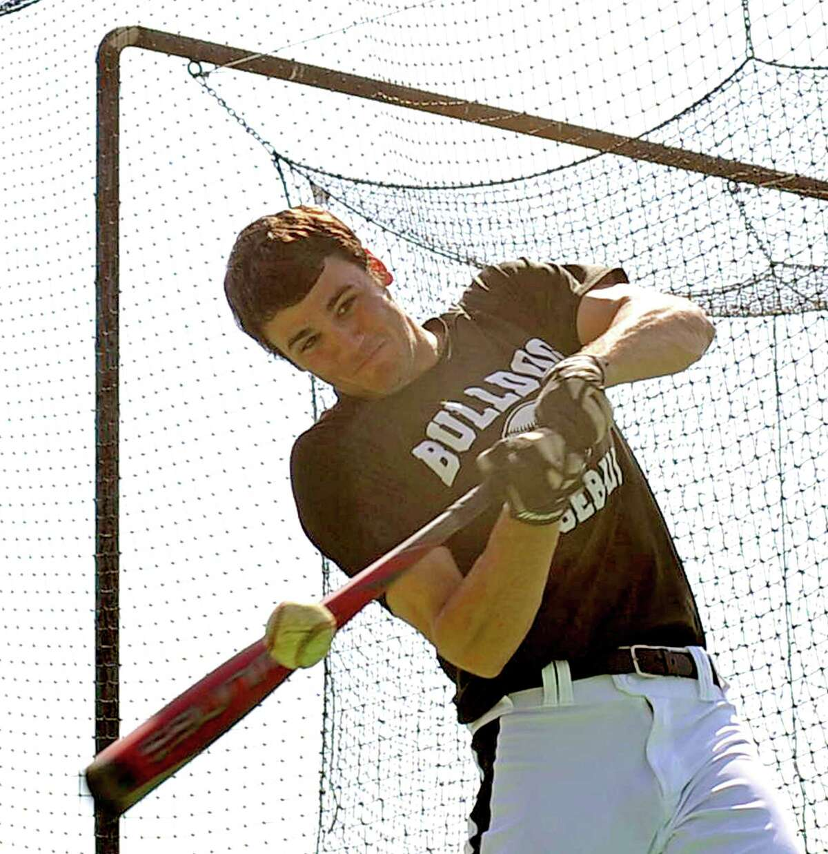 On Monday, the Nederland Bulldogs took to the field in preparation for their next game. Pitcher #18, Carson Raines, gets in some batting practice. The Nederland Baseball team, which is 12-2-2 this year and 2-0 in District 20-4A, will play the Little Cypress-Mauriceville Bears at 7 p.m. Tuesday March 19, 2013 Dave Ryan/The Enterprise