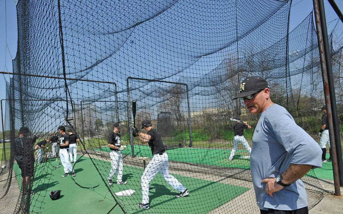 On Monday, the Nederland Bulldogs took to the field in preparation for their next game. Head Coach Cody Robbins, right, watches his players in the batting cages. The Nederland Baseball team, which is 12-2-2 this year and 2-0 in District 20-4A, will play the Little Cypress-Mauriceville Bears at 7 p.m. Tuesday March 19, 2013 Dave Ryan/The Enterprise