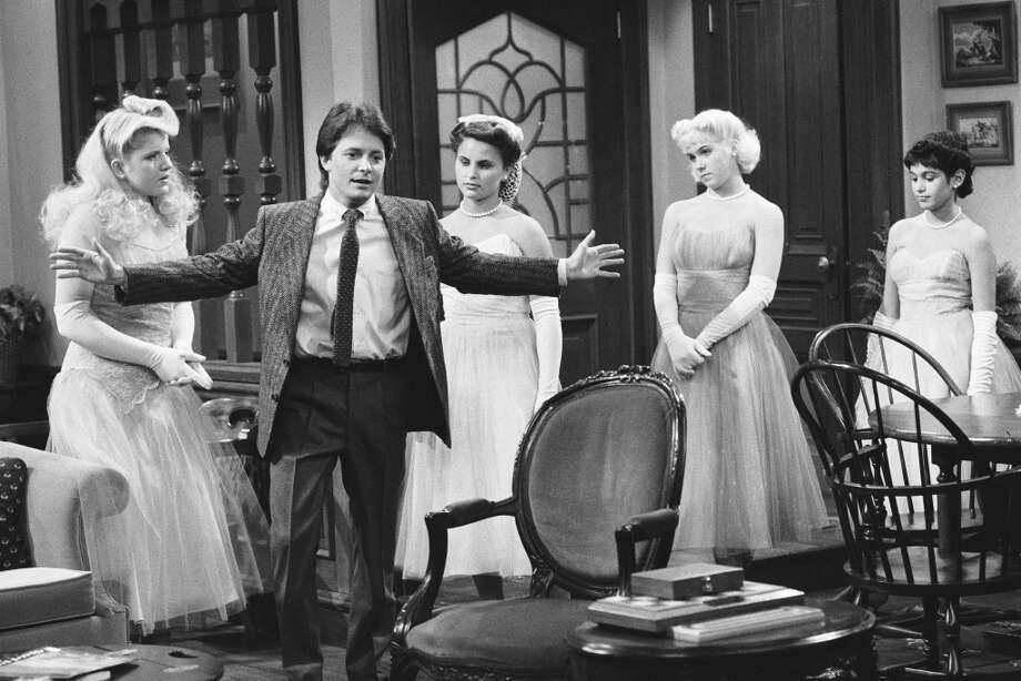Family Ties in 1987.  Pictured: (l-r) Tina Yothers as Jennifer Keaton, Michael J. Fox as Alex P. Keaton, Rain Phoenix as Ashley Berkhart, Christina Applegate as Kitten, unknown  -- Photo by: NBCU Photo Bank Photo: NBC, NBC Via Getty Images / © NBC Universal, Inc.