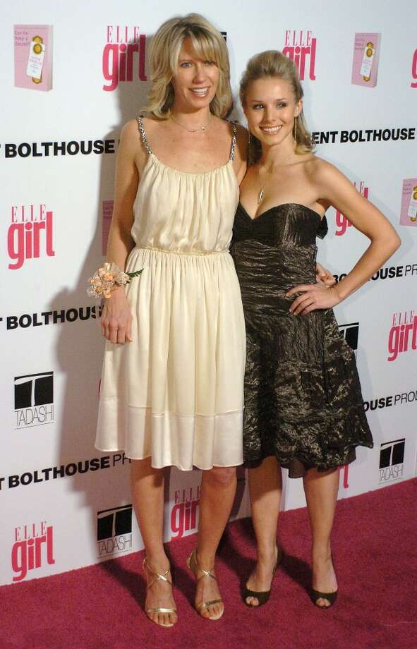 Actress Kristen Bell (right) and ELLEGIRL Magazine Editor-in-Chief Brandon Holley arrive at the First Annual ELLEGIRL Hollywood Prom party in 2005. Photo: Phil McCarten, Getty Images / 2005 Getty Images