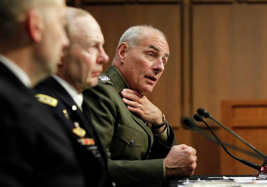 Marine Gen. John F. Kelly, USMC, Commander, U.S. Southern Command, right, testifies March 19 before the House Armed Services Committee on Capitol Hill on the defense budget and the situation at the Guantanamo Bay, Cuba, prison camp. Photo: Molly Riley, Associated Press / FR170882 AP