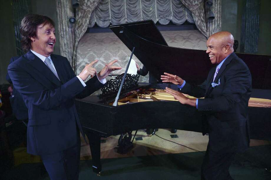 Paul McCartney (left) and Berry Gordy stand in front of  Motown's newly restored 1877 Steinway grand piano. Photo: Associated Press