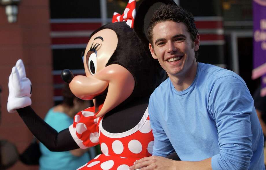 Actor Matt Marraccini of General Hospital rides with Minnie Mouse in the celebrity motorcade during ABC's Super Soap Weekend at Walt Disney World's MGM Studios November 13, 2005 in Orlando, Florida. This year marked the 10th anniversary of the event. Photo: Matt Stroshane, Getty Images / 2005 Matt Stroshane