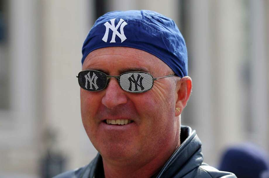 NEW YORK, NY - APRIL 01:  Peter Anderson waits outside of gate 4 before the game between the New York Yankees and the Boston Red Sox during Opening Day on April 1, 2013 at Yankee Stadium in the Bronx borough of New York City.  (Photo by Elsa/Getty Images) Photo: Elsa, Getty Images / 2013 Getty Images
