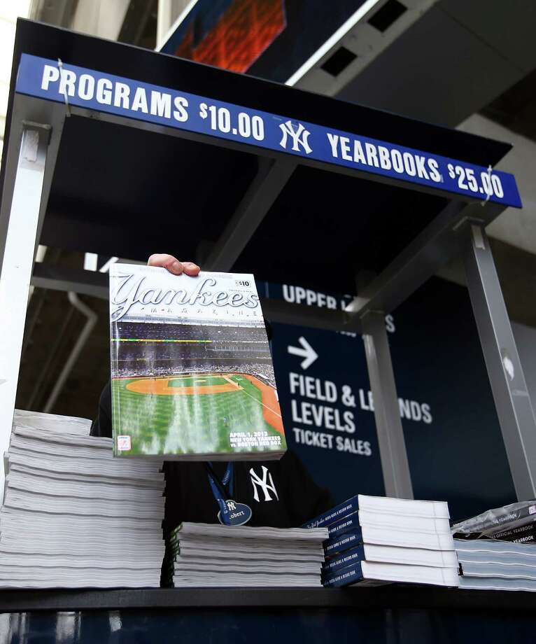 NEW YORK, NY - APRIL 01:  Game programs are displayed for sale before the game between the New York Yankees and the Boston Red Sox during Opening Day on April 1, 2013 at Yankee Stadium in the Bronx borough of New York City.  (Photo by Elsa/Getty Images) Photo: Elsa, Getty Images / 2013 Getty Images
