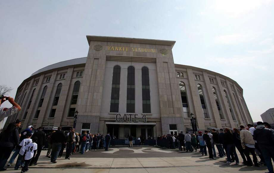 NEW YORK, NY - APRIL 01:  Fans enter the staduim before the game between the New York Yankees and the Boston Red Sox during Opening Day on April 1, 2013 at Yankee Stadium in the Bronx borough of New York City.  (Photo by Elsa/Getty Images) Photo: Elsa, Getty Images / 2013 Getty Images