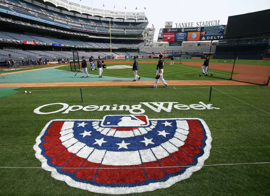 NEW YORK, NY - APRIL 01:  The New York Yankees warm up before the game against the Boston Red Sox during Opening Day on April 1, 2013 at Yankee Stadium in the Bronx borough of New York City.  (Photo by Elsa/Getty Images) Photo: Elsa, Getty Images / 2013 Getty Images