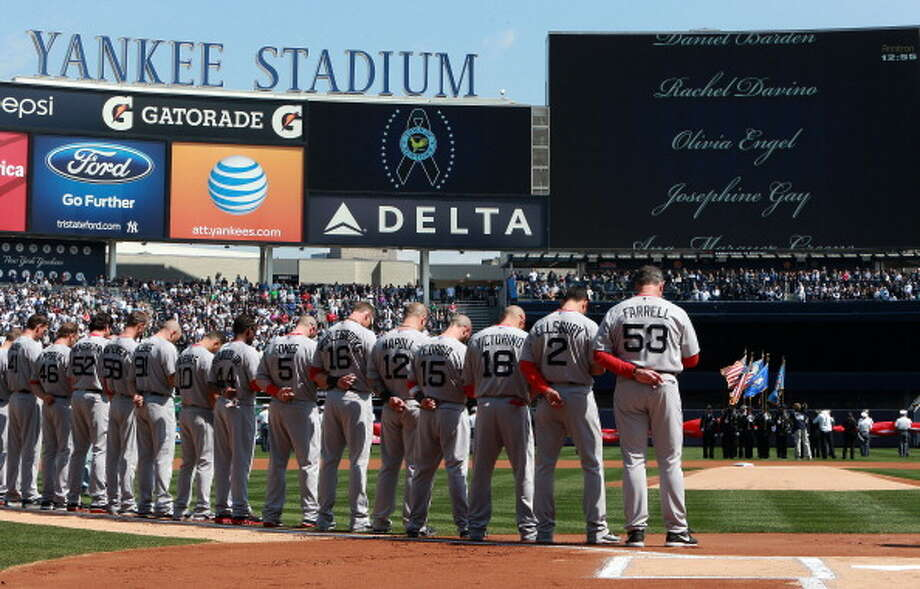 NEW YORK - APRIL 1: Moment of silence for victims of the Newtown shooting, before the game. The Boston Red Sox play the New York Yankees at Yankee Stadium during Opening Day of the 2013 MLB season. (Photo by Jim Davis/The Boston Globe via Getty Images) Photo: Boston Globe, Boston Globe Via Getty Images / Getty Images