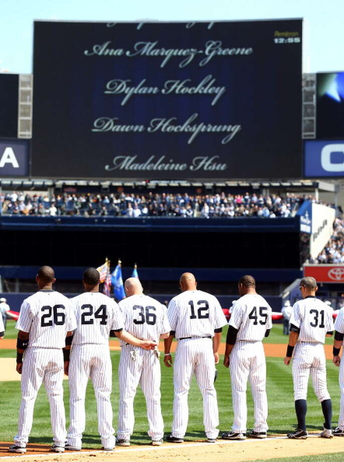 NEW YORK, NY - APRIL 01:  Names of the victims from the Newtown, Connecticut school shooting scroll accross the screen during a moment of silence before the game between the New York Yankees and the Boston Red Sox during Opening Day on April 1, 2013 at Yankee Stadium in the Bronx borough of New York City.  (Photo by Elsa/Getty Images) Photo: Elsa, Getty Images / Getty Images