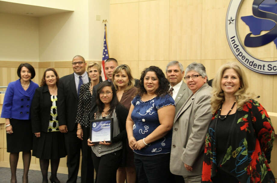 Pictured are Rachelle Gomez, center holding a plaque, who, along with three of her classmates, was recognized by the South San Antonio Independent School District board of trustees March 20. Photo: Courtesy Photo