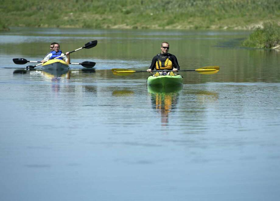 Kayakers travel down a newly completed stretch of Mission Reach March 26 at Padre Park in San Antonio. Photo: San Antonio Express-News