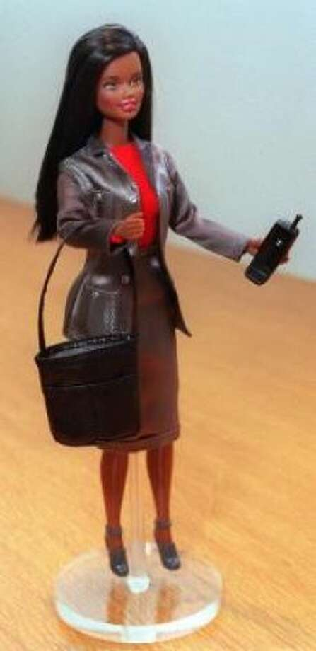 Working Woman Barbie, with a laptop and cell phone and business cards, arrived in 1999.