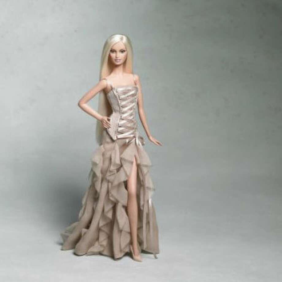 A 21st century Barbie models Versace.