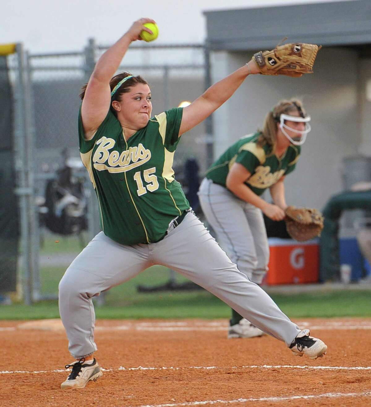 Lady Bear pitcher #15, Raven Cole winds up one of her fast balls. The Little Cypress-Mauriceville girls softball team played game one of a 3 game series against Richmond Foster Thursday night May 17, 2012 at Goose Creek Memorial High School in Baytown Texas. Dave Ryan/The Enterprise