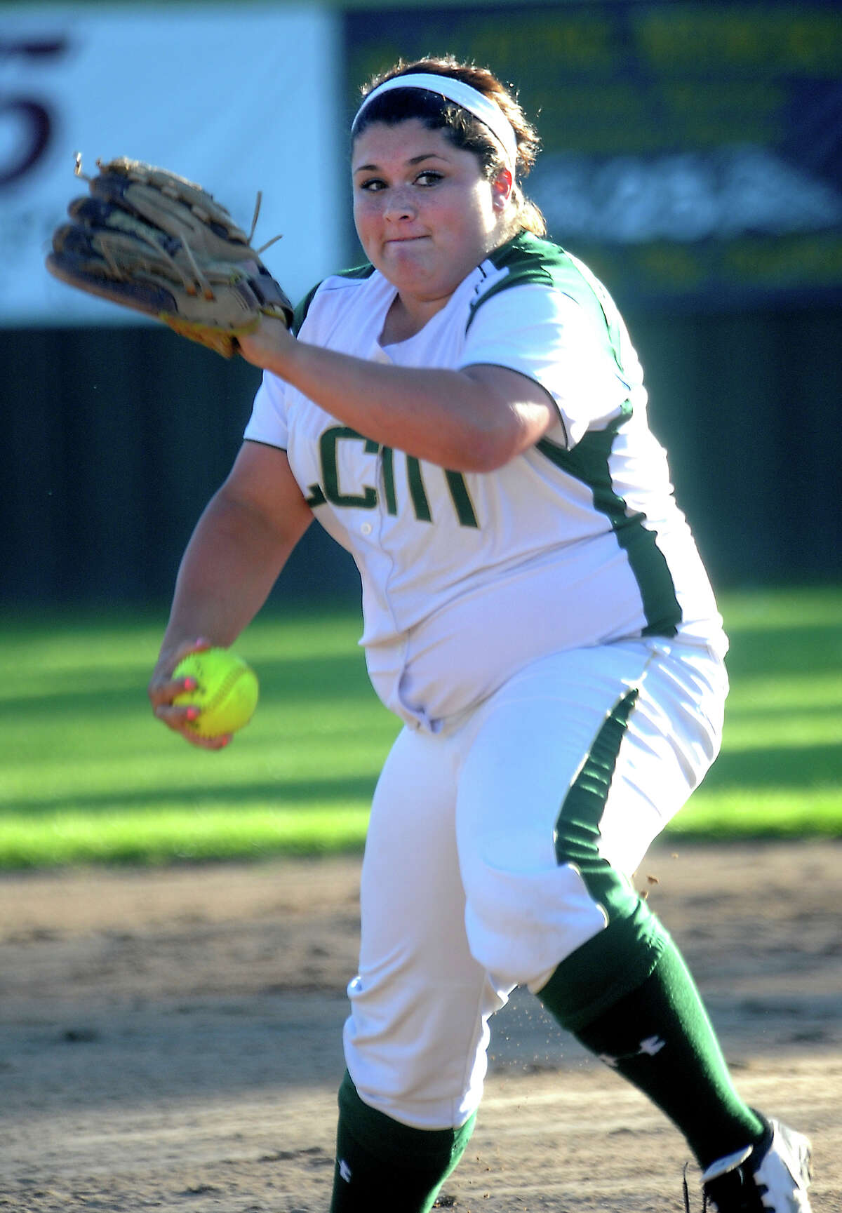 LCM's Raven Cole pitches against Nederland at Little Cypress-Mauriceville High School in Orange, Friday, March 23, 2012. Tammy McKinley/The Enterprise