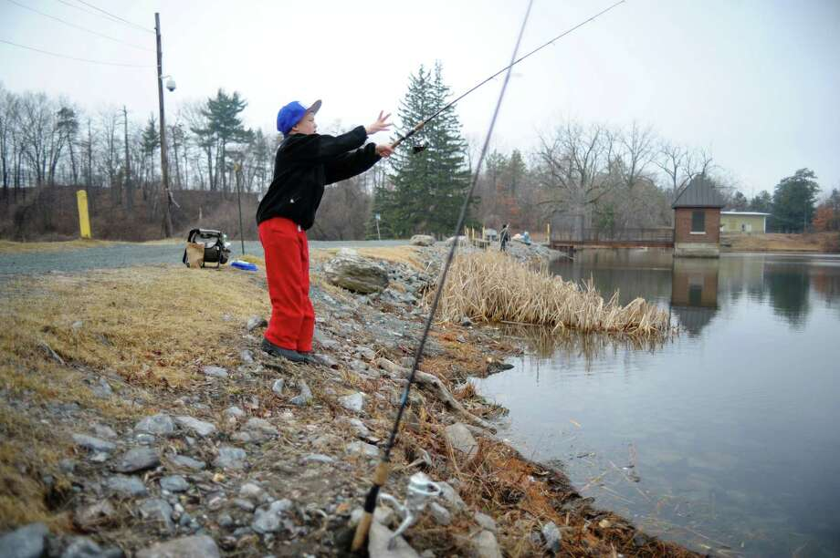Ethan Hall, 9, of Watervliet casts his line into the water at Six Mile Waterworks on Monday, April 1, 2013, in Albany, NY.  Department of Environmental Conservation staff stocked the lake with nearly 2,000 rainbow trout on Monday.  DEC staff also gave lessons on casting and about fishing in general.  (Paul Buckowski / Times Union) Photo: Paul Buckowski