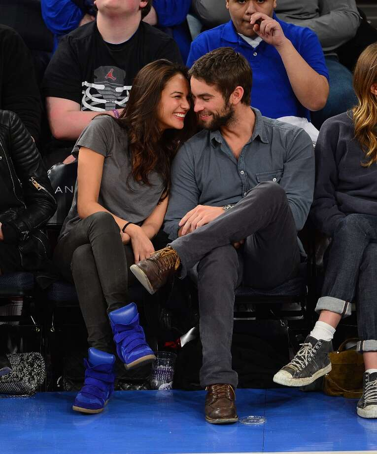 Chace Crawford (R) and cuddles with rumored new girlfriend Rachelle Goulding at the Charlotte Bobcats vs New York Knicks game at Madison Square Garden on March 29, 2013 in New York City. Photo: James Devaney, WireImage / 2013 James Devaney