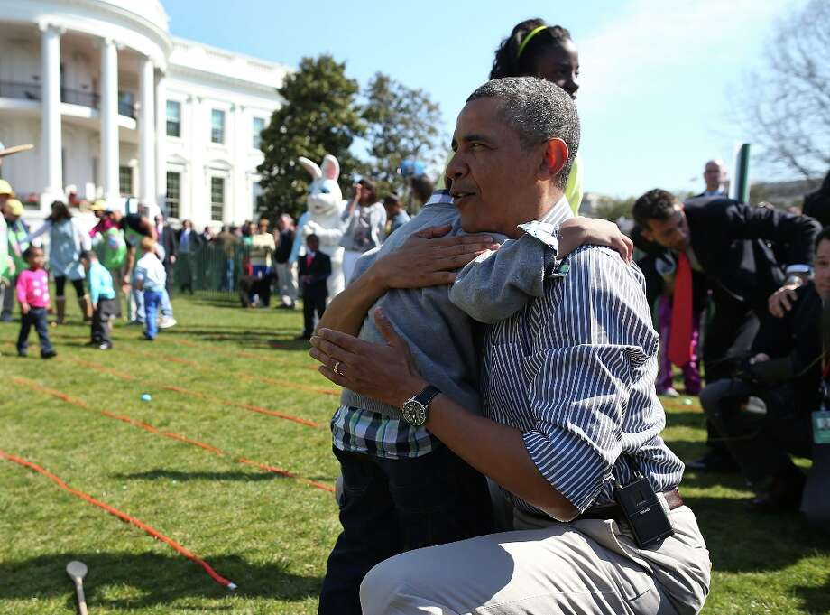 WASHINGTON, DC - APRIL 01:  U.S. President Barack Obama comforts crying 5 year old Donaivan Frazier during the annual Easter Egg Roll on the White House tennis court April 1, 2013 in Washington, DC. Thousands of people are expected to attend the 134-year-old tradition of rolling colored eggs down the White House lawn that was started by President Rutherford B. Hayes in 1878. Photo: Mark Wilson, Getty Images / 2013 Getty Images