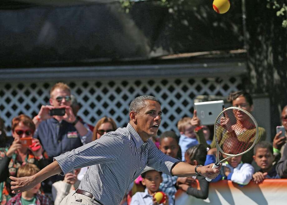 WASHINGTON, DC - APRIL 01:  U.S. President Barack Obama plays tennis with young children during the annual Easter Egg Roll on the White House tennis court April 1, 2013 in Washington, DC. Thousands of people are expected to attend the 134-year-old tradition of rolling colored eggs down the White House lawn that was started by President Rutherford B. Hayes in 1878. Photo: Mark Wilson, Getty Images / 2013 Getty Images