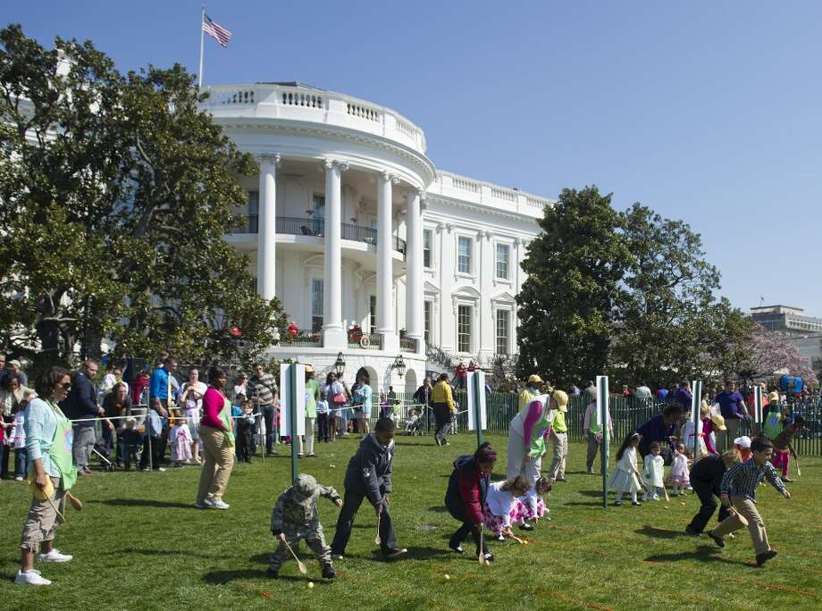 Children race to roll eggs as they participate in the White House Easter Egg Roll on the South Lawn of the White House in Washington, DC, April 1, 2013. US President Barack Obama hosts the annual event, featuring live music, sports courts, cooking stations, storytelling and Easter egg rolling. AFP PHOTO / Saul LOEBSAUL LOEB/AFP/Getty Images Photo: SAUL LOEB, AFP/Getty Images / AFP