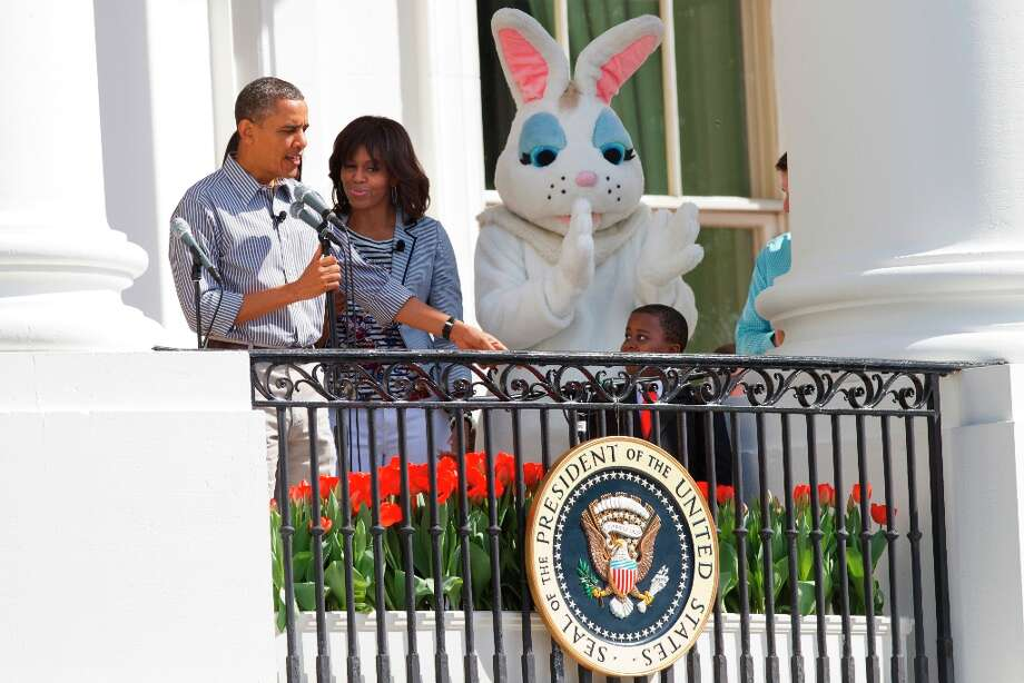 President Barack Obama, accompanied by first lady Michelle Obama, and the Easter Bunny, points toward Robby Novak, 9, of Henderson, Tenn., known as Kid President as he speaks from the Truman Balcony at the start of the annual White House Easter Egg Roll on the South Lawn of the White House in Washington, Monday April 1, 2013. (AP Photo/Jacquelyn Martin) Photo: Jacquelyn Martin, Associated Press / AP