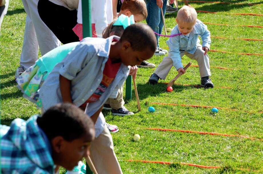 children participate in the annual White House Easter Egg Roll on the South Lawn of the White House in Washington, Monday, April 1, 2013. (AP Photo/Jacquelyn Martin) Photo: Jacquelyn Martin, Associated Press / AP