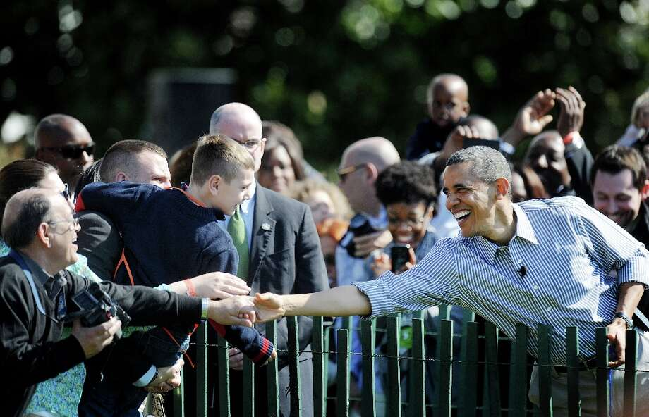 U.S. President Barack Obama greets guests during the annual Easter Egg Roll on the South Lawn of the White House April 1, 2013 in Washington, D.C. The First Family participated in the yearly event where the South Lawn is opened up to guests to participate in various egg rolls and other activities. (Olivier Douliery/Abaca Press/MCT) Photo: Olivier Douliery, McClatchy-Tribune News Service / Abaca Press