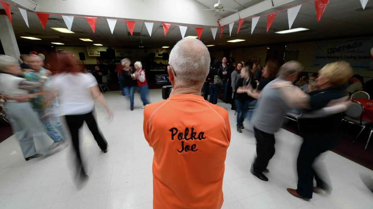 Polka Joe Trzeciak is surrounded by polka dancers during the Dyngus Day celebration April 1, 2013, at the Elks lodge in Rotterdam, N.Y. (Skip Dickstein/Times Union)