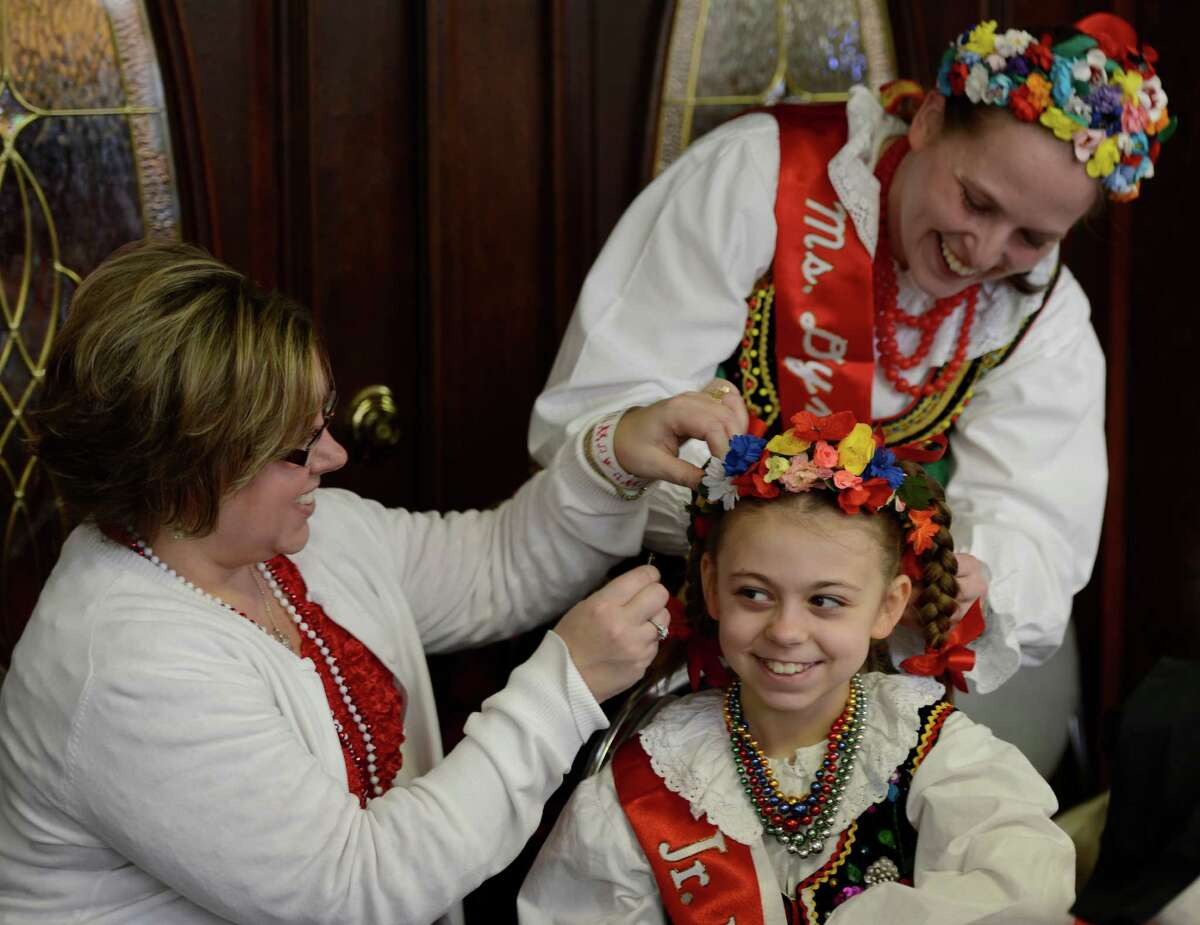Sherry Ryczek, left, works on her daughter Julianna Ryczek's costume with the help of Brenda Dudas, right, before she dances with the St. Adelbert's Dance Group during the Dyngus Day celebration April 1, 2013, at the Elks lodge in Rotterdam, N.Y. (Skip Dickstein/Times Union)