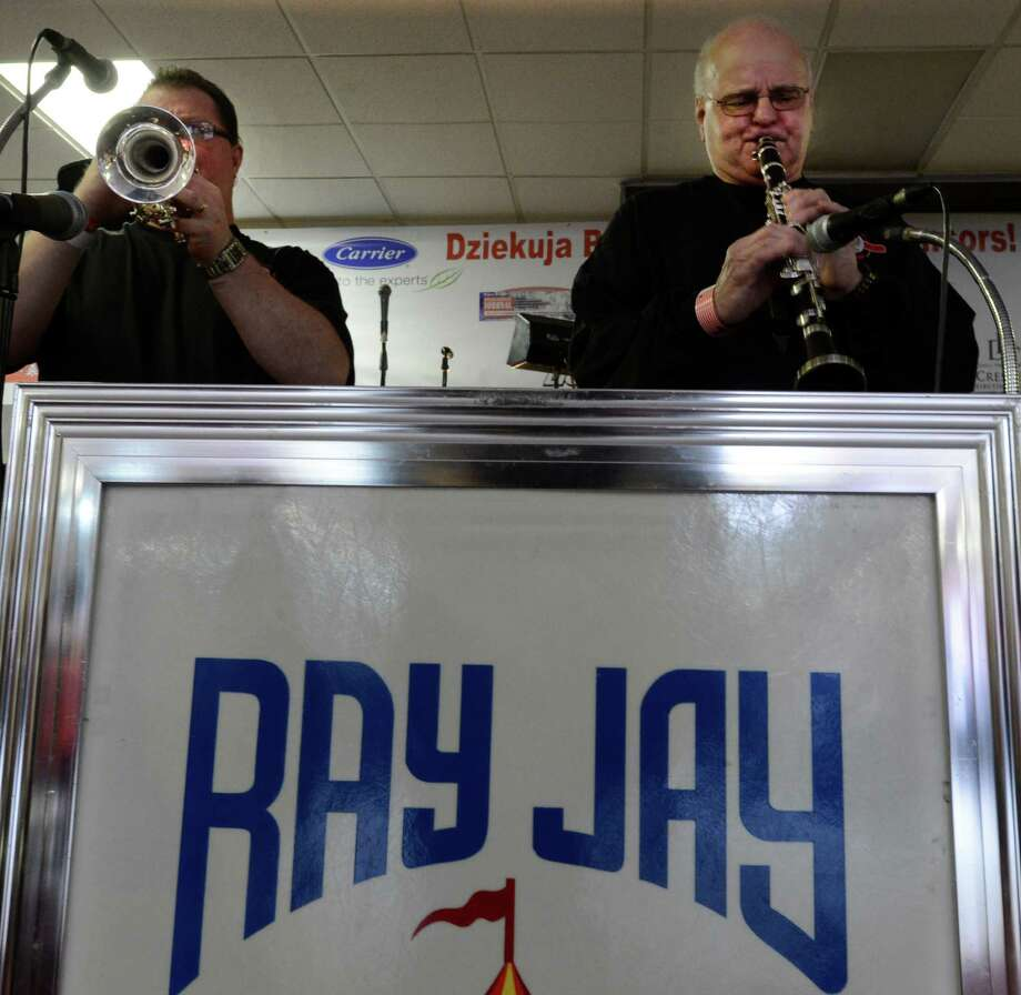 Rich Kois on trumpet, left, and Frank Gibala on clarinet, right swing out on polka music during the Dyngus Day celebration April 1, 2013,  at the Elks lodge in Rotterdam, N.Y.  Both musicians are members of the Ray Jay Carousel band of Pittsburgh.   (Skip Dickstein/Times Union) Photo: SKIP DICKSTEIN / 10021460A