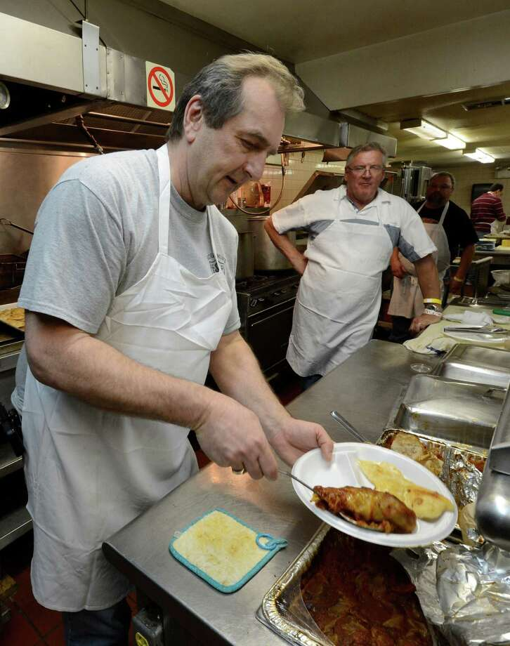 Head cook Jimmy Zalewski serves up some the 860 gloumbki, 350 dozen of pierogi and 200 lbs. of kielbasa during the Dyngus Day celebration April 1, 2013,  at the Elks lodge in Rotterdam, N.Y.   (Skip Dickstein/Times Union) Photo: SKIP DICKSTEIN / 10021460A