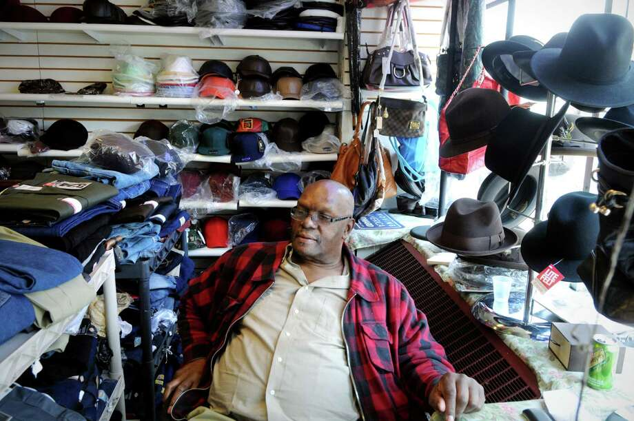 Alvin McKeithen, the owner of Adelle's Fabric & Fashion on Washington Blvd in Stamford, Conn., works in the store on Monday April 1, 2013. Photo: Dru Nadler / Stamford Advocate Freelance