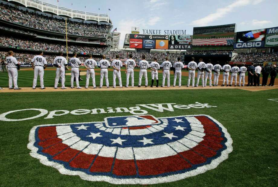 New York Yankees players line up on the baseline during introductions and a tribute to the Newtown, Ct., school shooting victims at an Opening Day baseball game at Yankee Stadium in New York, Monday, April 1, 2013. Photo: Kathy Willens, AP Photo/Kathy Willens / Associated Press