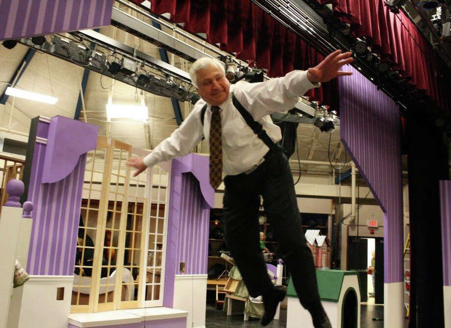 "Westport School Superintendent Elliott Landon spreads his wings on the set of ""Peter Pan"" at Coleytown Middle School. The schools chief was suspended with rigging set up by a flying-effects company hired for the Coleytown student performance, which is scheduled April 5 to April 7. Photo: Contributed Photo / Westport News"