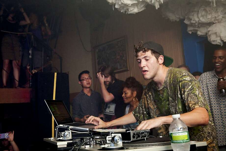 "DJ and producer Baauer performs at Glasslands Gallery in Brooklyn. Versions of his ""Harlem Shake"" are the latest example of YouTube's power to create hits. Photo: Julie Glassberg, New York Times"