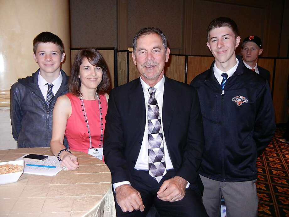 Brothers Donny (left) and Tyler Petersen (far right) with their mom, Giants Community Fund Executive Director Sue Petersen, and Giants manager Bruce Bochy at the Hilton Hotel for the Play Ball Lunch. Photo: Catherine Bigelow, Special To The Chronicle