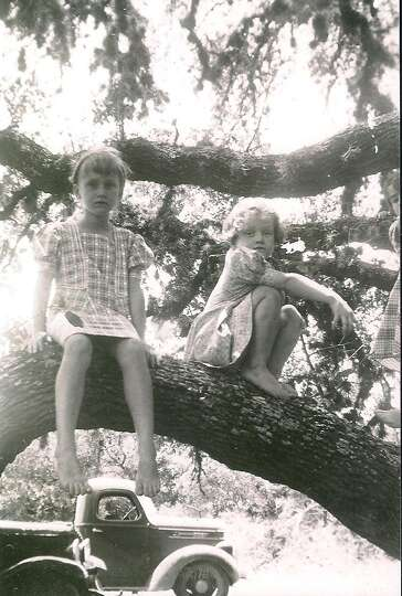 Then: In 1939, the Heard sisters, Nell, 6, and Sydney, 4, play in a large tree in their grand
