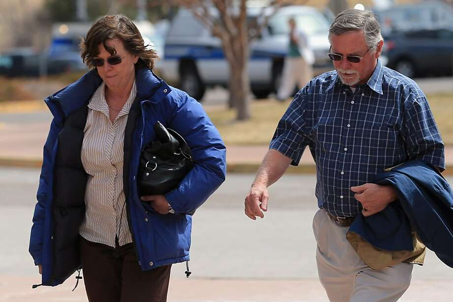 Arlene and Robert Holmes, parents of defendant James Holmes, arrive at the courthouse. Photo: Doug Pensinger, Getty Images