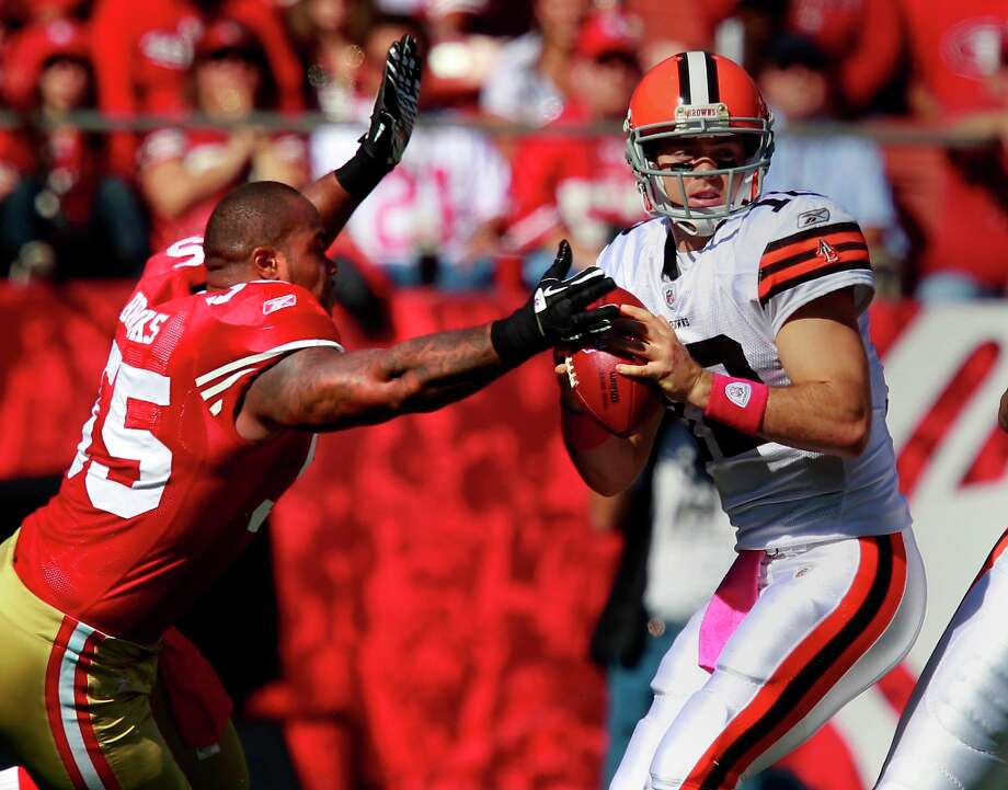 Ahmad Brooks (55), without a helmet, got to Browns quarterback Colt McCoy in the first quarter and forced a fumble. The San Francisco 49ers defeated the Cleveland Browns 20-10 at Candlestick Park Sunday October 30, 2011. Photo: Brant Ward, The Chronicle / ONLINE_YES